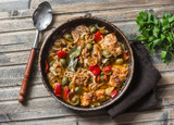 Slow cooker chicken with olives and sweet peppers in the pan on wooden background, top view. Comfort food - 173725848