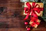 packaging christmas gifts in boxes on wooden background top view - 173736067