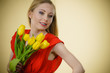 Pretty woman with yellow tulips bunch - 173751655