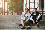 Dreamy students on break outside. Two happy men background, street hipster style, young males outdoors - 173766262