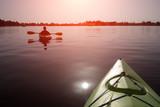 Boy in life jacket on green kayak - 173774024