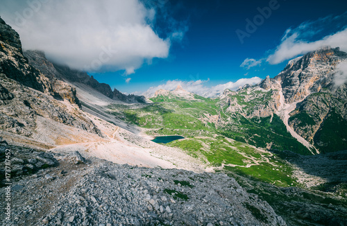 Foto op Aluminium Bleke violet Unusual alpine lake in the National Park Tre Cime di Lavaredo (Three peaks of Lavaredo, Drei Zinnen). Trentino Alto Adidge, Dolomites, Alps, Italy