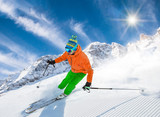 Skier skiing downhill in high mountains - 173793682