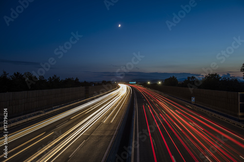 Foto op Canvas Nacht snelweg colorful light trace from highway traffic at night