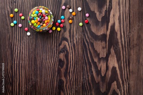Colorful candies on wooden table - 173798009