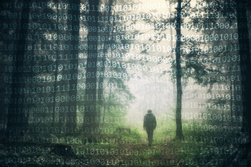 Man walking alone in magical dark green colored foggy wild forest landscape with abstract binary numbers background. © robsonphoto