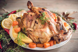 Close up whole roasted turkey served on the plate with potatoes,selective focus - 173813662
