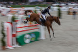 Abstract image with a moving rider and horse at show jumping - 173815841