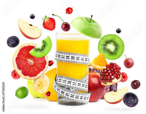 Mixed fruits falling and orange juice