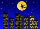 Befana che vola sopra la città di notte - 173829014
