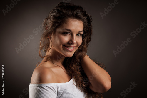 Keuken foto achterwand Kapsalon Attractive young woman over dark gray background - beauty portrait