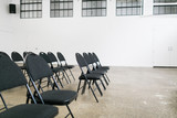 Black chairs in an auditorium - 173851624