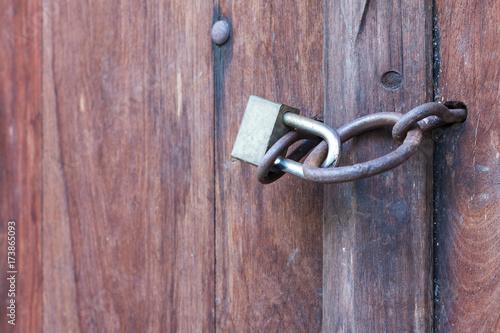 Lock key on old wooden door. Poster