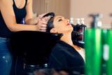 Portrait of women which wash hair in a beauty salon - 173879406