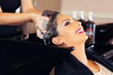 Portrait of women which wash hair in a beauty salon - 173879409