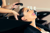 Portrait of women which wash hair in a beauty salon - 173879432