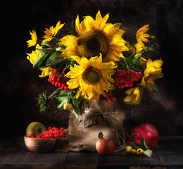 Still life with sunflowers, fruits and berries