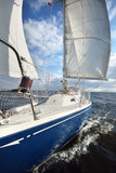 View from a sailboat's bow with mast and full sails - 173902694