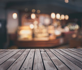 Wooden table top grunge surface over blur cafe interior background - 173903623