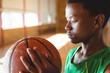 Teenage boy looking at basketball
