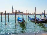 Gondolas moored in the Venetian lagoon. Venice, Italy - 173927435