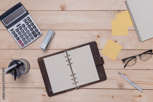 Fridge magnet Topview of wooden desk with office tools and plant