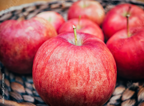 wooden basket with big red apples. Macro shot - 173939686