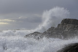 Big wave splash against cliff - 173944669