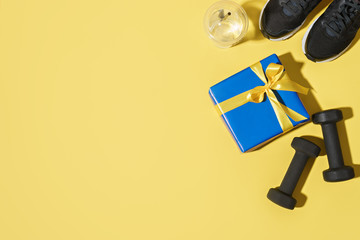 sport gift box and fitness equipment  . bright background