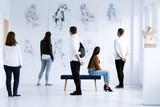 Visitors in art gallery - 173988646