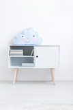 Blue cloud pillow on cupboard - 173990067