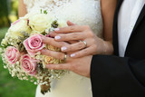 man and woman hands with wedding rings - 174004406