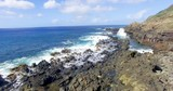 Low flying aerial shot over a rocky beach in Hawaii - 174032423