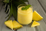 Smoothie with pineapple on the grey wooden background - 174041672
