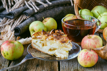 Pie with organic apples and hot brewed tea