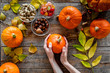 Pumpkin harvest. Pumpkins near nuts and autumn leaves on wooden background top view