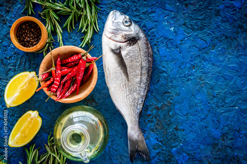 Dorado fish with spices ready to cook on blue background top view copyspace - 174045013
