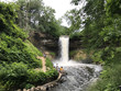 Beautiful view of Minnehaha Falls in Minneapolis Minnesota on a bright green summer morning. Public park open for hiking trails and outdoor activity