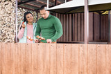 Attractive couple cooking shashlik out-of-doors - 174060438
