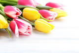 Bouquet of bright tulips on white wooden table - 174062035