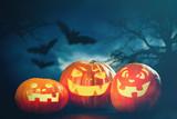 Three halloween Jack O' Lantern pumpkins - 174068209