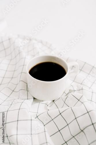 Coffee mug on cloth. Minimal concept.
