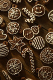 Traditional homemade Christmas ginger and chocolate cookies decorated with white sugar painting - 174072261