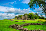 Landscape of Inch Abbey in Northern Ireland. Monastery ruins in Downpatrick. Co. Down. Travel by car in summer. - 174073640