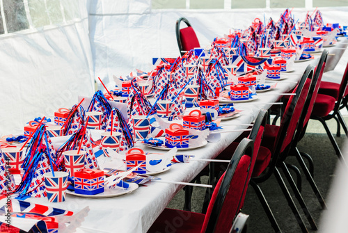 Foto Murales Long tables with red, white and blue party accessories at a Royal event street party