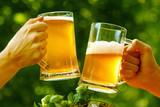 Oktoberfest fun cheers, beer mugs in hands - 174077887