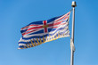 British Columbia flag waving over blue sky in Vancouver, BC, Canada