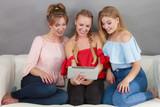 Three women using tablet - 174131250