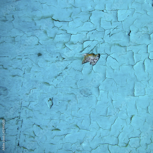 Metal texture covered with a turquoise old paint