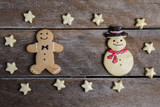 Festive Christmas Cookie and New Year in the shape of Gingerbread man, snowman, Snowflake, star on wooden table - 174165292
